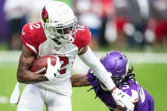 Cardinals receiver Pharoh Cooper (12) runs with the ball up during the second quarter of a game against the Vikings at U.S. Bank Stadium.