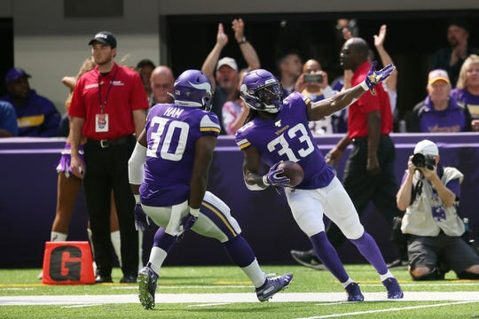 Minnesota Vikings running back Dalvin Cook celebrates with teammate CJ Ham (30) after scoring on an 85-yard touchdown run in the first half of an NFL preseason football game against the Arizona Cardinals, Saturday, Aug. 24, 2019, in Minneapolis.