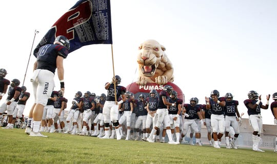 Perry football players prepare to run onto the field before their game with Pinnacle in Gilbert, Friday, Aug. 23, 2019.