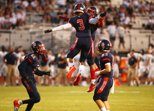 Centennial High running back Jaydin Young (3) celebrates his touchdown against Casteel High in the first half on Aug. 23, 2019 in Peoria, Ariz.