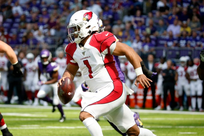 Arizona Cardinals quarterback Kyler Murray scrambles up field during the first half of an NFL preseason football game against the Minnesota Vikings, Saturday, Aug. 24, 2019, in Minneapolis.