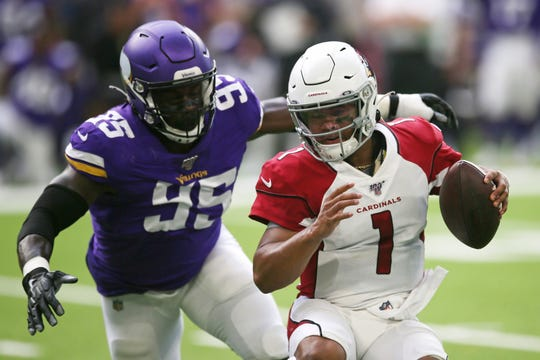 Arizona Cardinals quarterback Kyler Murray (1) runs from Minnesota Vikings defensive end Ifeadi Odenigbo (95) during the first half of an NFL preseason football game, Saturday, Aug. 24, 2019, in Minneapolis.