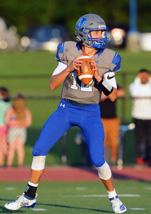 Cedar Crest QB Chris Danz drops back to pass during last season's Cedar Bowl.