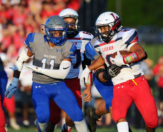 Lebanon's Nathaniel Portes (6) is chased down by Cedar Crest's Aadyn Richards.