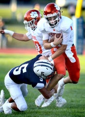 Central York's Beau Pribula is hit by West York's Avery Handy during football action at West York Friday, Aug. 23, 2019. Bill Kalina photo