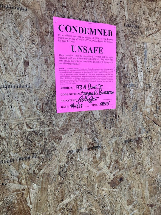 A condemned sign was posted on the businesses within the Yorktown Mall after a fire at the Panaderia Bakery.