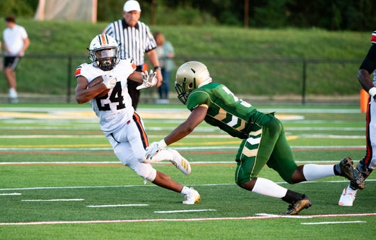 Nate Banks (24) evades a tackle during the football game between York Catholic and York Suburban at York Catholic High School, Friday, August 23, 2019. The Trojans lead the Fighting Irish 20-6.