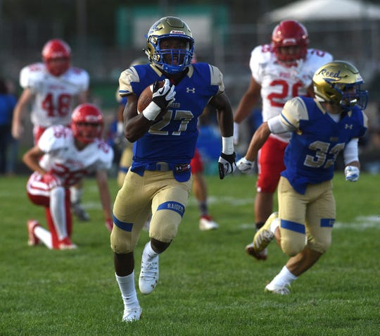 Reed's Elijah Tau-Tolliver (27) runs free for a touchdown while taking on Wooster during their football game in Sparks on Aug. 23, 2019.