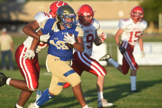 Reed's Chris Williams (18) runs while taking on Wooster during their football game in Sparks on Friday night.