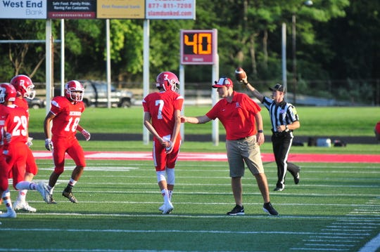 Richmond head coach Tony Sonsini gives freshman quarterback Drew VanVleet direction in their 41-21 win over Connersville on Friday, Aug. 23, 2019.