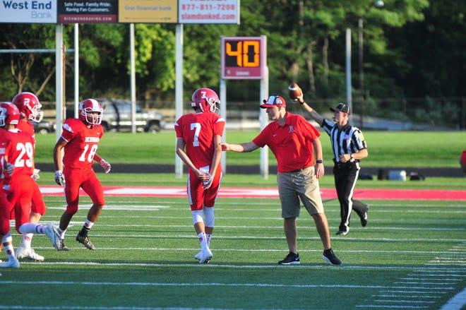 Richmond head coach Tony Sonsini gives freshman quarterback Drew VanVleet direction in their 41-21 win over Connersville on Friday, Aug. 23, 2019.