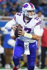 Buffalo Bills quarterback Josh Allen (17) scrambles during the second quarter against the Detroit Lions at Ford Field.