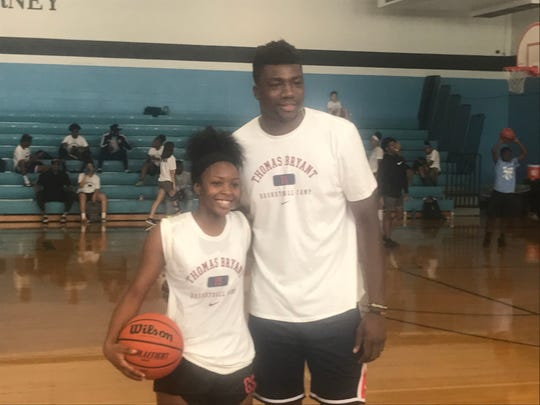 Washington Wizards center Thomas Bryant poses India Jordan, a rising senior at School of the Arts, in-between sessions at the first Thomas Bryant Basketball Camp at Bishop Kearney.