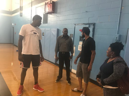 Washington Wizards center Thomas Bryant talks with friends and family members during a basketball camp he wanted to set up at Bishop Kearney.