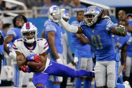 Buffalo Bills wide receiver Zay Jones (11) pulls in a reception next to Detroit Lions defensive back Johnathan Alston Friday night.