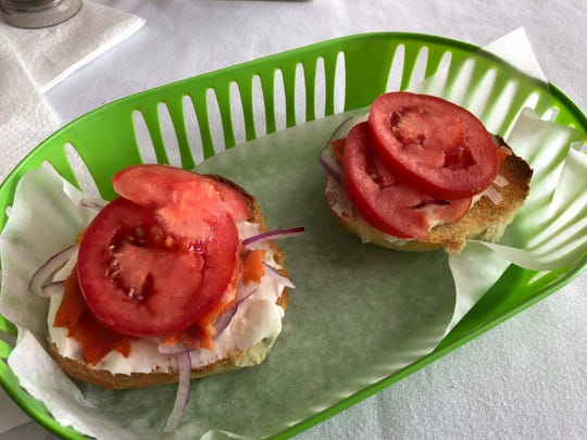 The lox bagel sandwich at the Bagel Deli, with cream cheese, tomato and red onion.