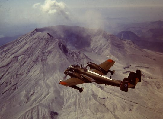 The military plane involved in the fatal crash at the Stuart Air Show was an OV-1 Mohawk. Here, the Mohawk does surveillance after Mount St. Helens erupted 1980.