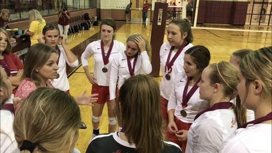 Miles High School volleyball coach Courtney Lange congratulates her team for its efforts in winning the 2019 Bronte Showdown Saturday, Aug. 24, 2019, in Bronte.