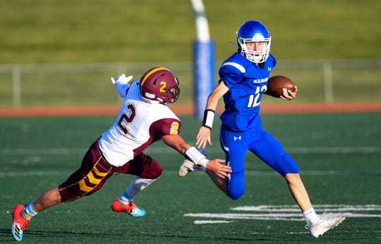 Sterling Rausch of the Webster Area Bearcats attempts to tackle Dylan Kindt of the Garretson Blue Dragons in their game Friday night, August 23, in Garretson.