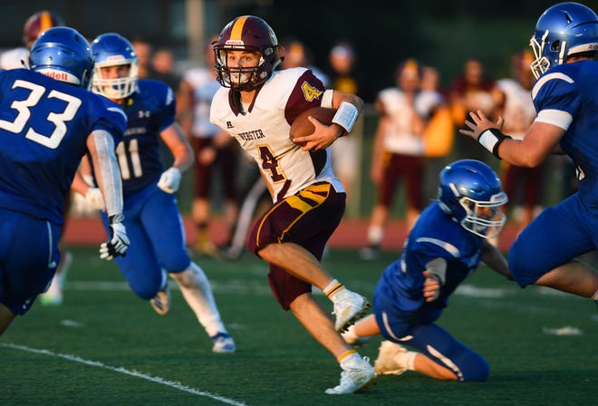 Braden Holland of the Webster Area Bearcats moves through a slew of Garretson Blue Dragons in the first football game of the season on Friday night, August 23, in Garretson.