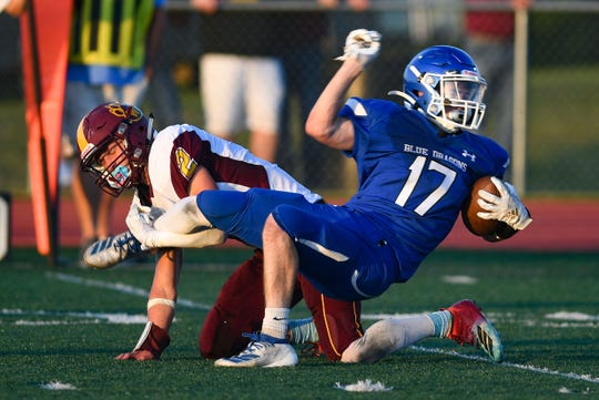 Cole Skadsen of the Garretson Blue Dragons is tripped by Sterling Rausch of the Webster Area Bearcats in their game Friday night, August 23, in Garretson.
