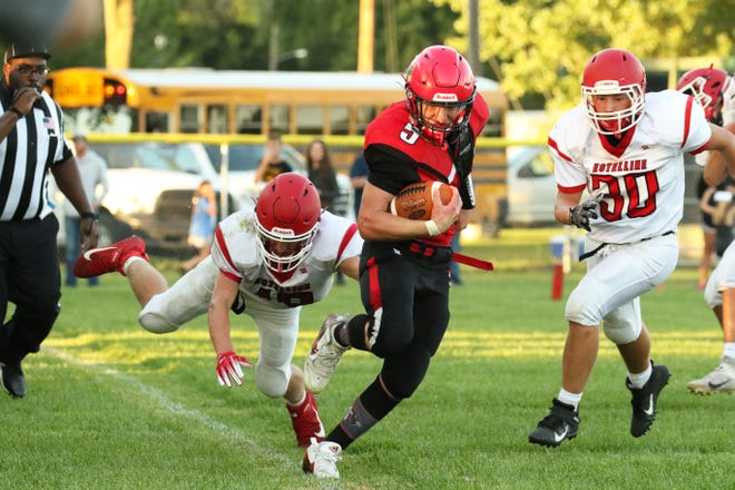 Eli Longville of Dell Rapids St Mary toes the line ahead of Estelline-Hendricks' Hezikiah Kreger (30) on Friday night in Dell Rapids.