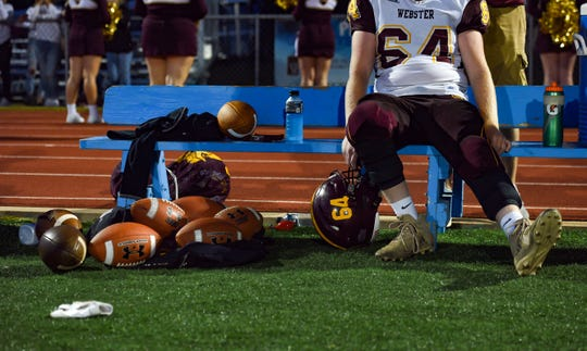 Kaden Lesnar of the Webster Area Bearcats sits on a bench after coming off the field during a game against the Garretson Blue Dragons on Friday night, August 23, in Garretson.