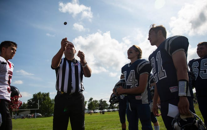 Burke High School football team faces Lyman High School football team during the coin toss at Tolstedt field, Friday, Aug. 23.
