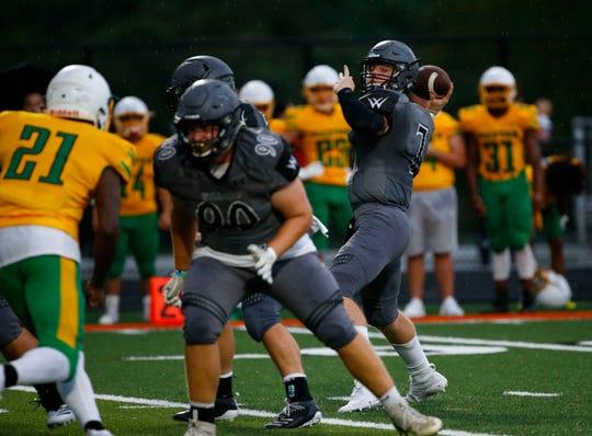 Willard quarterback Reece Dawson looks for an open receiver during a preseason jamboree game at Republic on Friday, August 23, 2019.