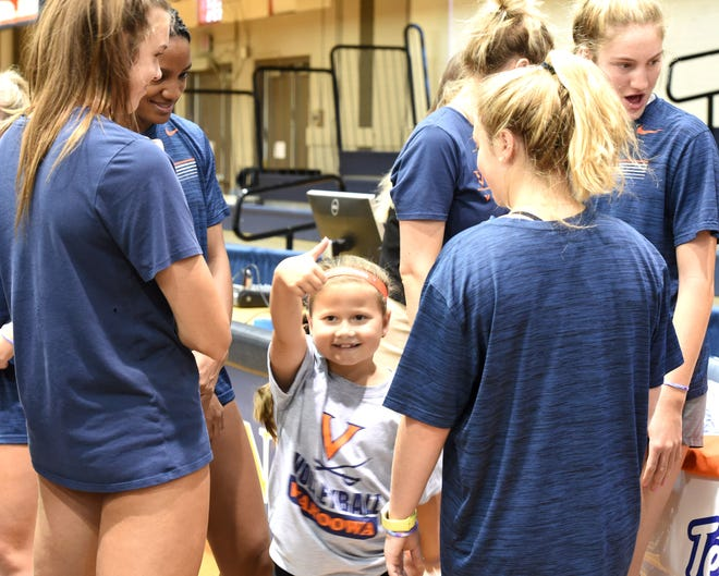 Thumbs up from 8-year-old Aida Aleshire Saturday after joining the UVA volleyball team. The Crimora girl, who has Type 1 diabetes, got the opportunity through Team Impact.
