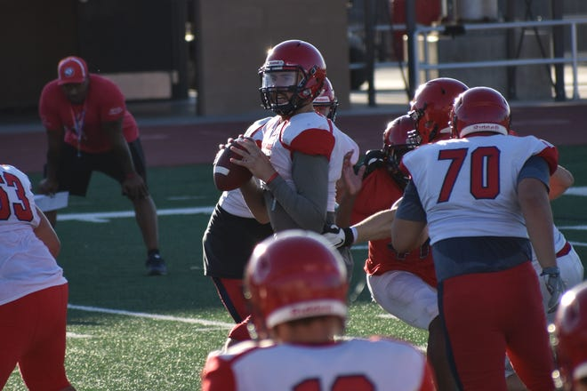 Dixie State, and former Pine View star, Kody Wilstead surveys the field during fall practice.