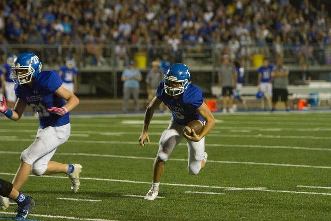 Dixie High School quarterback Reggie Graff runs the ball in this file photo from the Flyers' 41-21 win over Roy on Friday, Aug. 23, 2019.