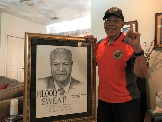 "George ""Godfather"" Thompson was very close with Jake Gaither. He proudly showcases his framed drawing of the iconic football coach."