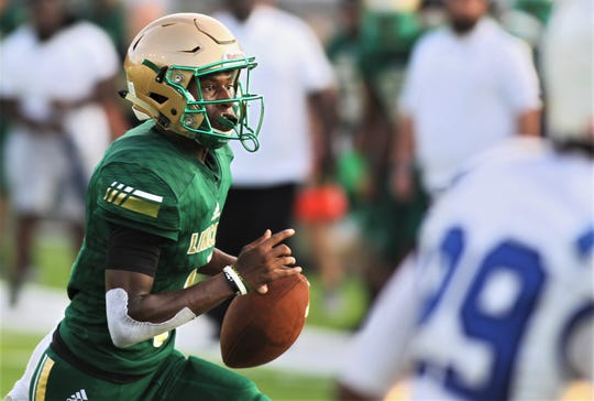 Lincoln quarterback Chris Beard runs for a touchdown as Lincoln beat Godby 32-12 on Friday, Aug. 23, 2019.