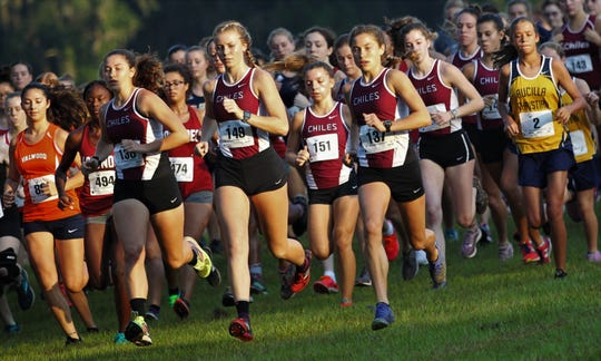 Chiles seniors Megan Churchill, Emily Molen and Alyson Churchill lead a pack of Timberwolves and other runners out at the start of the Dueling Summits cross country meet at Tallahassee's Eleanor Klapp-Phipps Park on Saturday, Aug. 24, 2019.