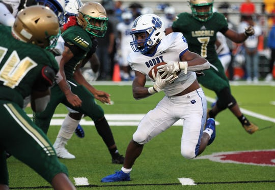 Godby running back Jackell Leland looks for running room as Lincoln beat Godby 32-12 on Friday, Aug. 23, 2019.