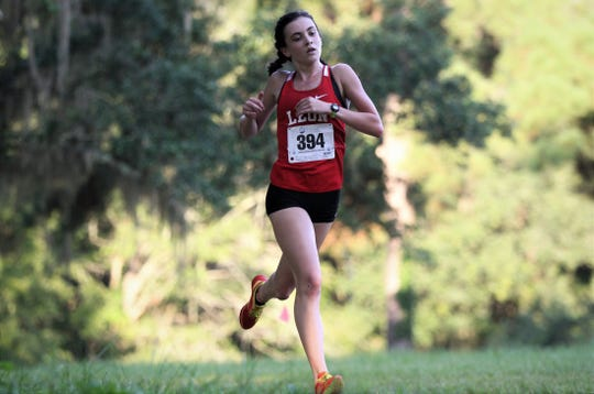 Leon junior Avery Calabro races to a second-place finish at the Dueling Summits cross country meet at Tallahassee's Eleanor Klapp-Phipps Park on Saturday, Aug. 24, 2019.