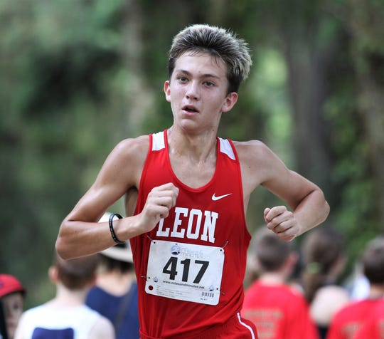 Leon freshman Jake Rogers races to a fourth-place finish at the Dueling Summits cross country meet at Tallahassee's Eleanor Klapp-Phipps Park on Saturday, Aug. 24, 2019.