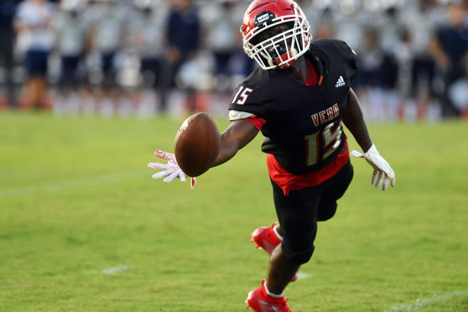 Vero Beach's Tyrese Simmons reaches for a ball during the Fighting Indians' 7-3 win against Delray Beach-American Heritage on Aug. 23. Vero Beach has postponed its game Friday because of Hurricane Dorian.