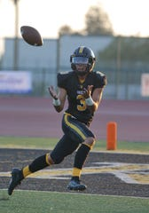 Ventura High wide receiver Daniel Gutierrez brings in a touchdown catch during the Cougars' 51-14, season-opening win over Royal on Friday night.