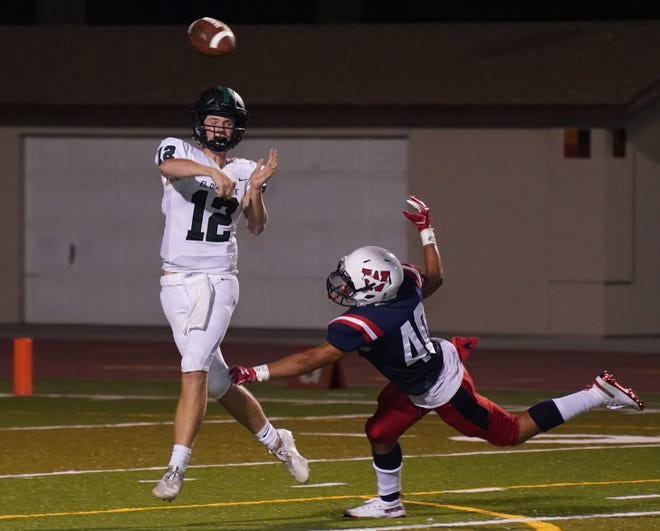 El Diamante's Justin Vink attempts to get away from Tulare Western's Isaac Infante in a non-league high school football game at Bob Mathias Stadium on Friday, August 23, 2019.