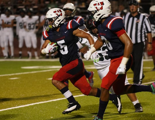 Tulare WesternÕs Mikey Fisher runs for a touchdown against El Diamante in a pre-league high school football game at Bob Mathias Stadium on Friday, August 23, 2019.