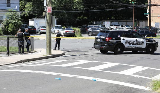 Yonkers police stand near the intersection of Van Cortlandt Park Avenue and Coyle Place in the city, after a house party that had some disagreement, escalated to violence Aug. 24, 2019.