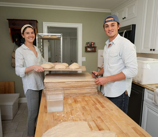 "Madison Goldrick and Chase Harnett, a bread baker from Ossining, create loaves of bread Aug. 24, 2019. He places his mobile ""bread box"", called the Hudson Oven Bread Box in various communities, inviting people to purchase loaves of bread, using an honor system."