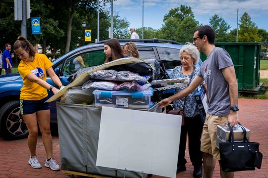 University of Delaware first-year students move into residence halls Saturday morning.