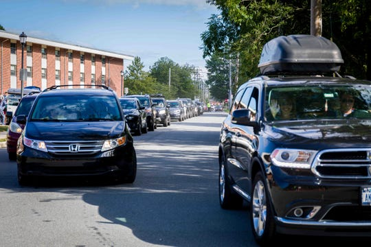 Cars gridlocked on Haines Street as first-year students move into the University of Delaware residence halls Saturday morning. Traffic was impacted throughout the day.