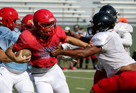 Hirschi's Tryston Randall is stopped in a scrimmage against Wichita Falls High Friday, Aug. 23, 2019, at Memorial Stadium.