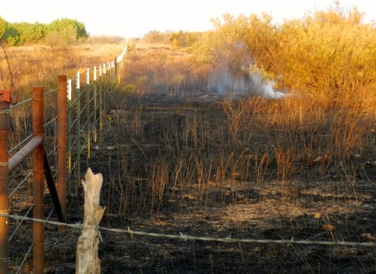 Dry conditions, a spark ignite fire burning in Foard County
