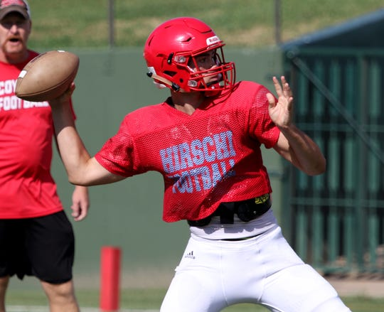 Hirschi's Tryston Randall passes in a scrimmage against Wichita Falls High Friday, Aug. 23, 2019, at Memorial Stadium.