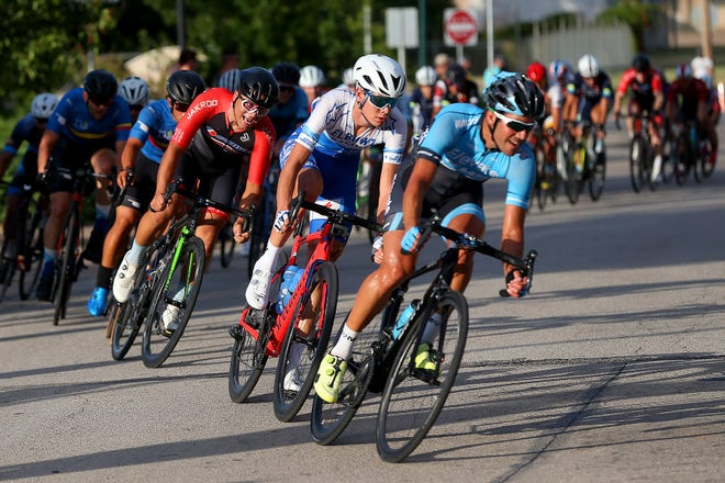 Racers fight for position during the 2019 Men's Hotter 'N' Hell Hundred criterium at the Wichita Falls Multi-Purpose Events Center as shown in this Aug. 23, 2019, file photo.